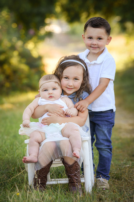 Photo of 3 children in a park