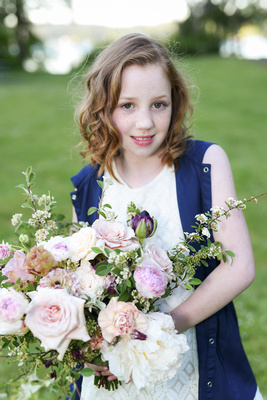 little girl with floral bouquet